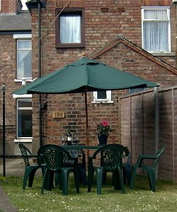 Secluded rear garden with garden furniture